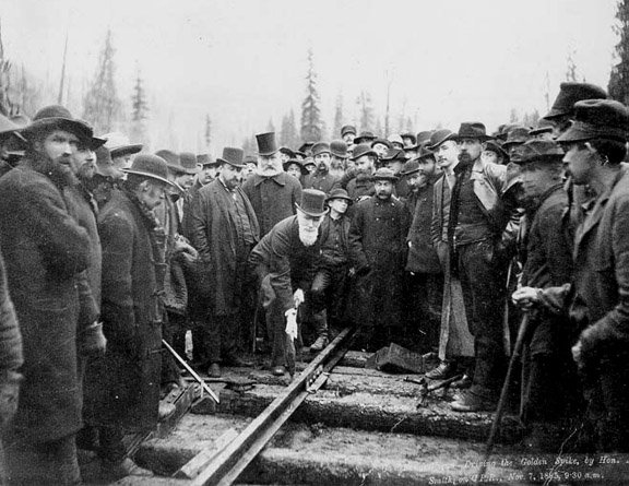 Financier Donald Smith hammers the CPR's last spike at Craigellachie, BC in 1885